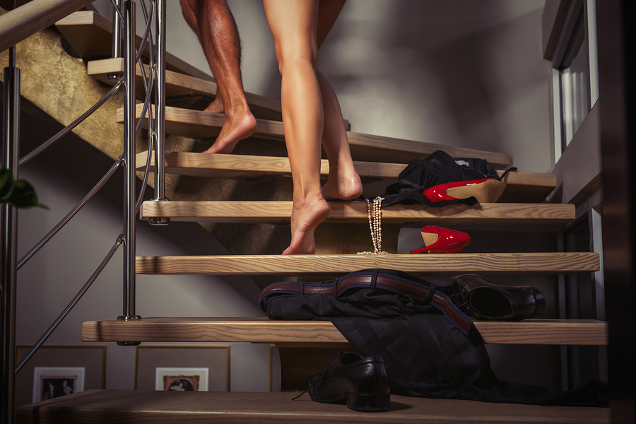 Couple going up stairs to the bedroom