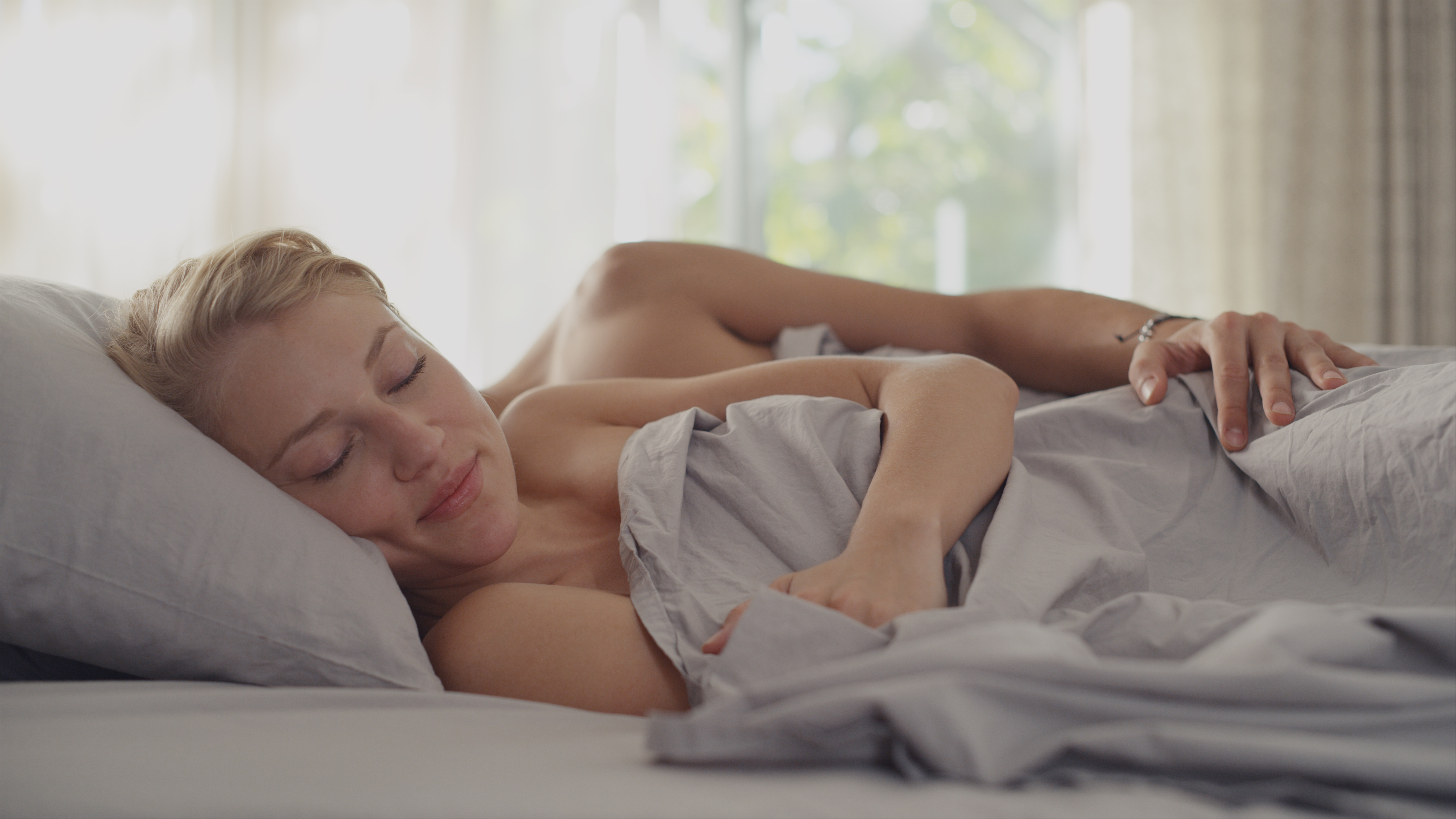 women in bed happy after sex