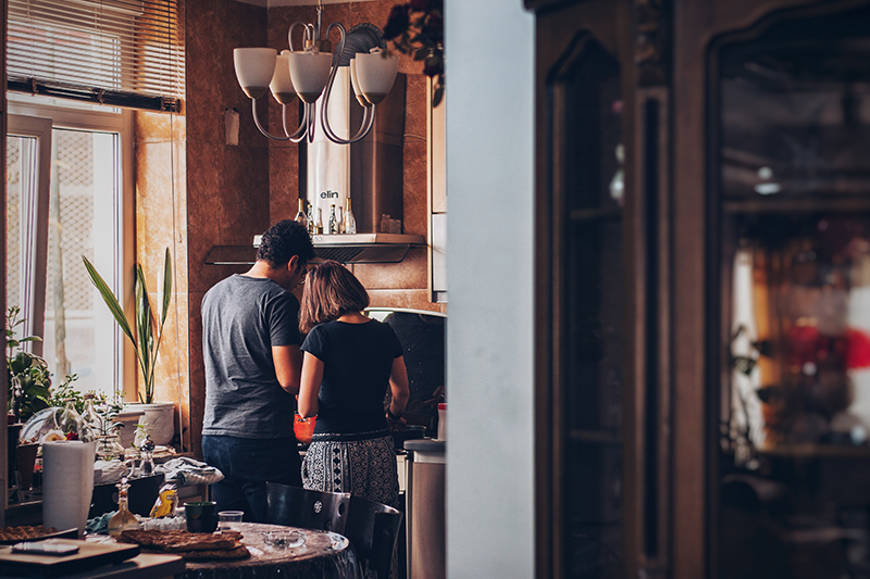 couple cooking together on date night