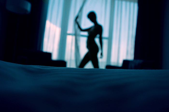 sexy female silhouette in bedroom