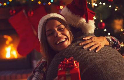 couple hugging during the holidays