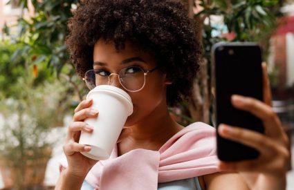 woman taking selfie for online dating app