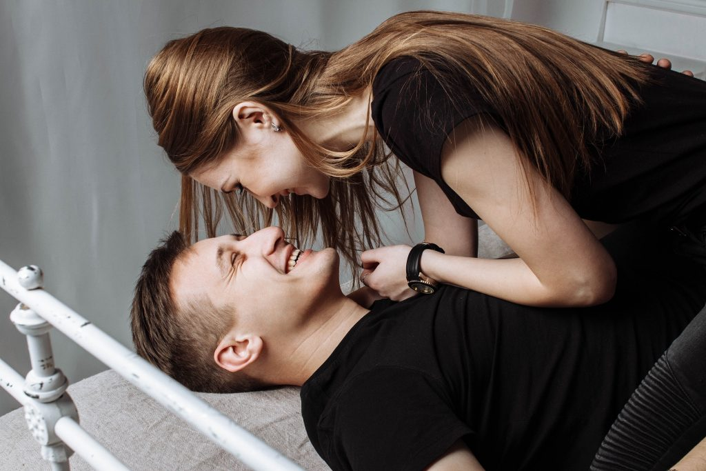 woman on top of man